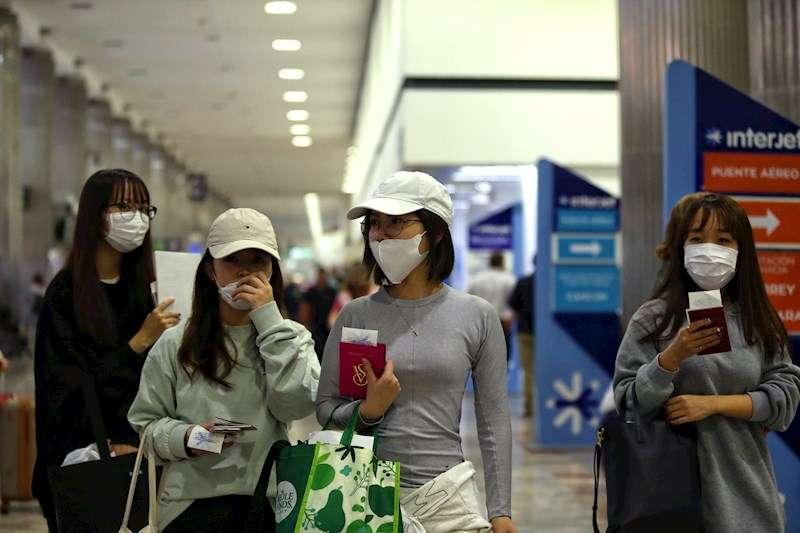 Ciudadanas chinas con mascarillas. EFE